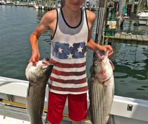 Kids out stiped bass fishing with Southbound Fishing Charters out of Waterford, CT