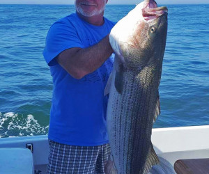 Striper fishing abourd Southbound Charters out of Waterford, CT